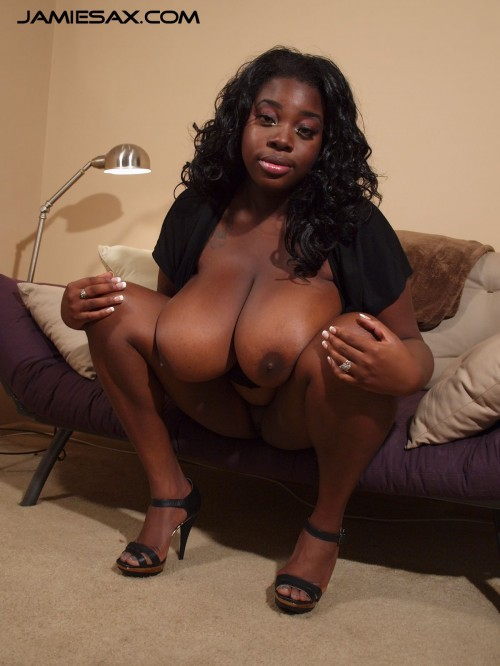 Jamie Sax, the big tit ebony milf exposes her huge boobs.
