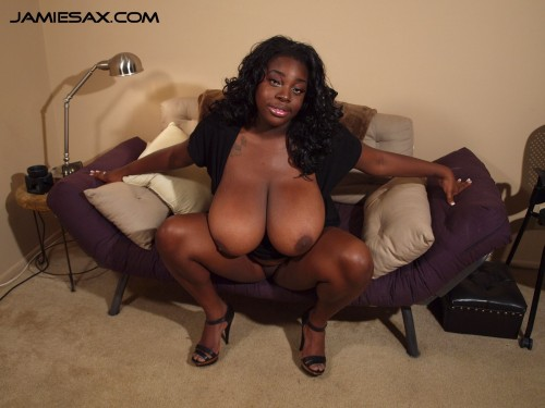 Jamie Sax, the big tit ebony milf shows off her huge boobs.